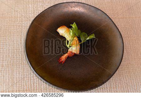 Crispy Shrimp Spring Rolls On Plate On Dinner Table
