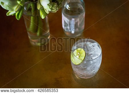 Top View Glass Or Fresh Sparkling Mineral Water With Slice Of Lime