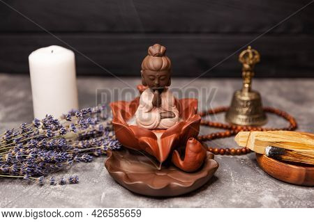 Candle Incense. Calming Zen Interiors With Buddha Statue. Buddha Statue In The Smoke Of Incense On B