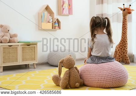 Lonely Little Girl With Toy Bunny At Home, Back View. Autism Concept