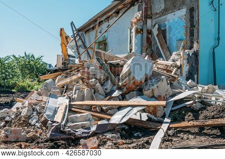 Pile Of Concrete Brick Wall From Demolished Building. House Destruction.