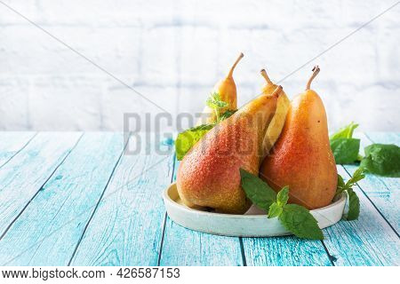Fresh Juicy Pears Conference On Blue Wooden Bright Background. Autumn Harvest Of Ripe Fruit. Copy Sp