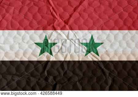 Nation Flag Of Syrian Arab Republic An Uneven Textured Surface. Flag Of Country Located In Middle Ea