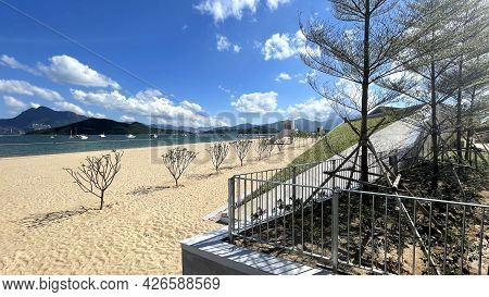 The Wide Natural Photography Beach Photo With Lifeguide Station, Tree, Clouds And Ocean Water