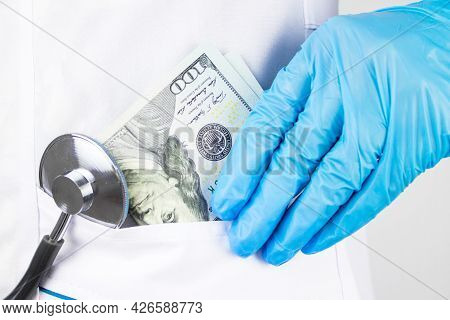 Woman Doctor Took Money. The Corruption Concept. Doctor Hand With Money. Doctor Hand Putting Money I