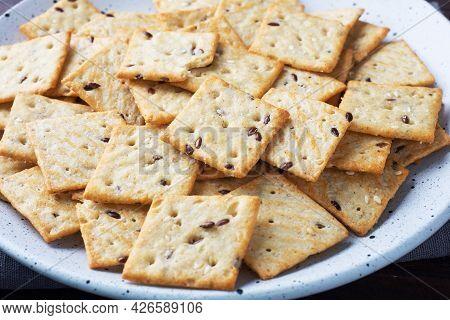 Delicious Healthy Cookies Crackers With Flax Seeds And Sesame Seeds On A Plate. Background Of A Heal