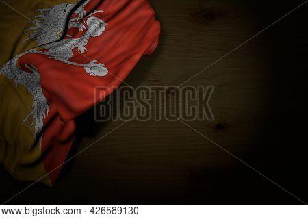 Pretty Feast Flag 3d Illustration  - Dark Photo Of Bhutan Flag With Large Folds On Dark Wood With Fr