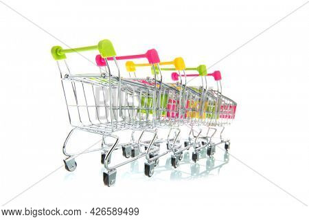 Row empty shopping carts isolated white background