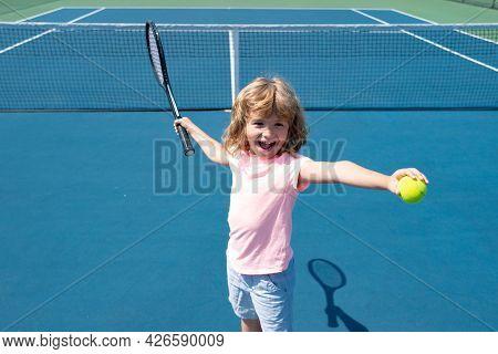 Kid Tennis Player On Tennis Court. Boy Hitting Forehand In Tennis.