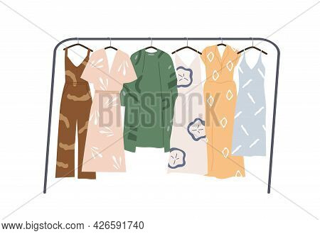 Modern Wardrobe Of Summer Clothing Hanging On Floor Hanger Rack. Casual Women Apparels. Collection O