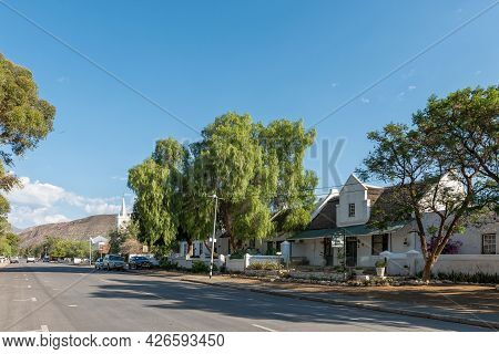 Prince Albert, South Africa - April 20, 2021: A Street Scene, With Guest Houses In Historic Building