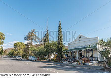 Prince Albert, South Africa - April 20, 2021: A Street Scene, With The Lazy Lizard Restaurant, In Pr