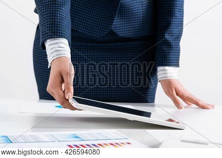 Businesswoman Standing Near Office Desk And Using Tablet Computer. Banking And Financial Management.