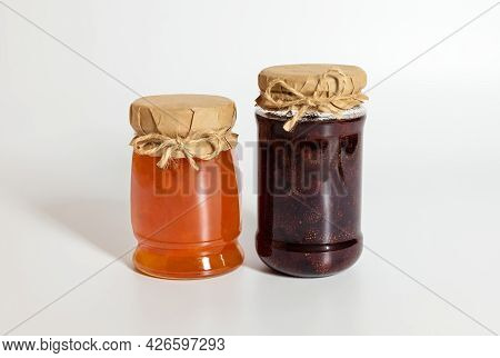Berry And Fruit Jam On A White Background. Strawberry And Apricot Jam.
