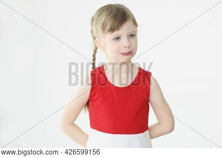 Portrait Of Little Offended Girl On White Background