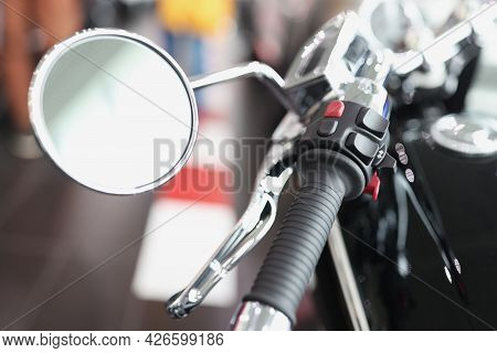 Motorcycle Mirror With Throttle Handle On Handlebars Closeup