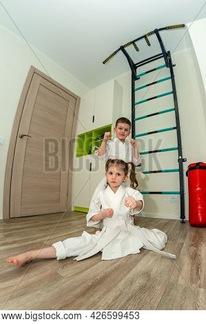Little Boy And Girl Of Preschool Age Go In For Sports Of Karate, Martial Arts