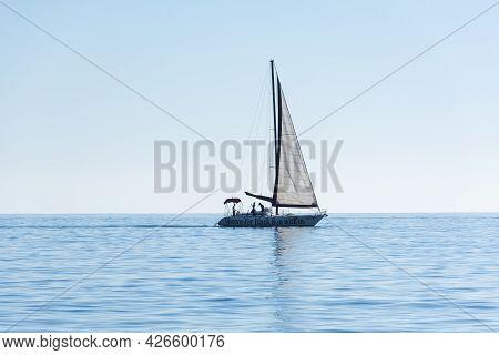 Balaklava Crimea On November 04, 2018. On The Horizon Is A Small Tourist Yacht With White Sails. Com
