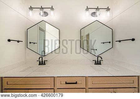 Double Vanity Sink With Wooden Cabinet And Matching Fixtures