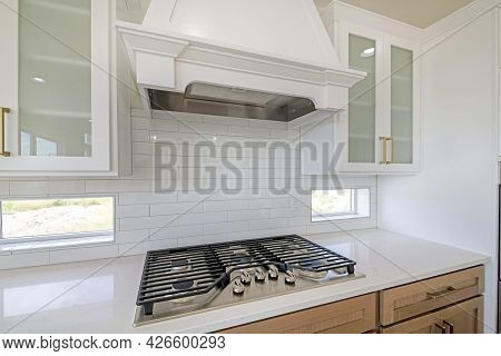 White Kitchen Counter With Built-in Gas Cooktop With Griddle In Stainless Steel
