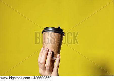 Hands Holding Cups Brown Paper With Black Lid. Coffee Special Offer Or Promo. Hands Holding Cups On