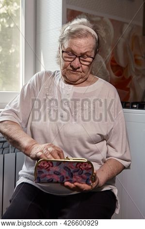 The Older Woman Counts The Money. An Elderly Woman Caucasian Old Woman Gray-haired Grandmother Takes