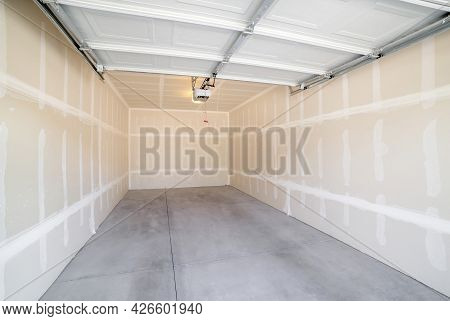 Interior Of A Detached Garage With Open Automatic Single Door