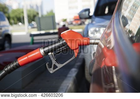 Refueling A Car At A Gas Station. Refueling A Car In The City. Blurred Background With Car