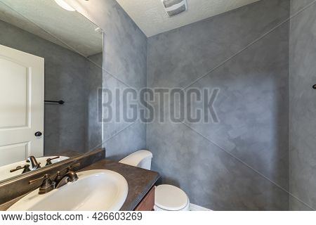 Small Bathroom Interior With Faux Paint Concrete Wall