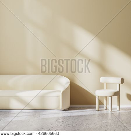 Modern Minimalistic Design Of Living Room With Light Beige Armchair And Sofa With Sunbeams On Wall,