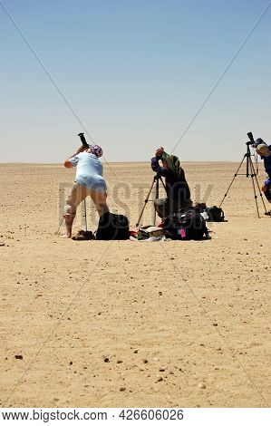Waw Al Kabir, Libya - March 29, 2006: Tourists Preparing To Observe The Total Solar Eclipse From A R