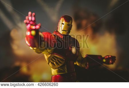 JUNE 12 2021:  Action scene with a retro vintage Iron Man armor suit - Hasbro action figure