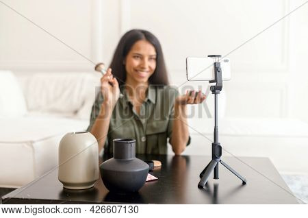 Charming Glamorous Indian Woman Beauty Vlogger Doing Makeup In Front Of Smartphone On The Tripod And