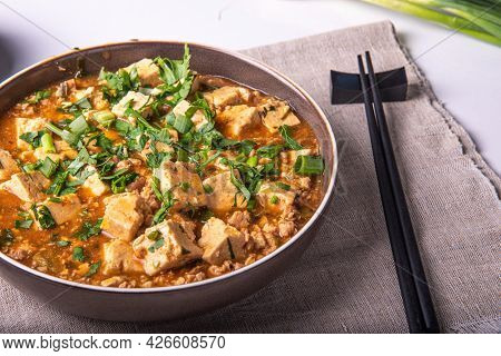 Mapo Tofu In A Bowl On A Linen Napkin With Chopsticks Close-up