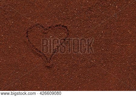 Ground Coffee With Heart Pattern. The Texture Of The Ground Coffee.