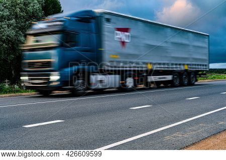 Moscow region, Russia - July, 4, 2021: Blurred truck on a speedway at sunset in Moscow region, Russia