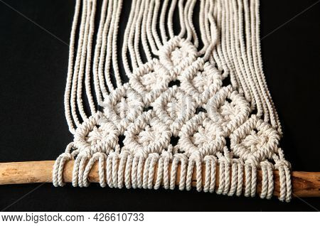 Close-up Of Hand Made Macrame Texture Pattern. Handmade Macrame 100 Cotton Wall Decoration With Wood
