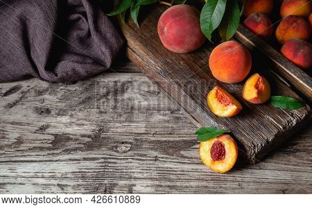 Juicy Ripe Peaches On Dark Wooden Rustic Table With Copy Space. Delicious Farm Peaches With Leaves W