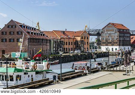 Klaipeda, Lithuania - Juny 24, 2021: Beautiful View On Tourist Boat, Dane River, Embankment And Bric