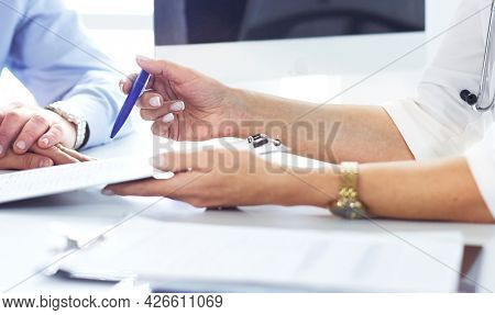 doctor prescribes medication to the senior patient