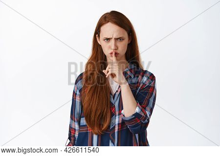 Image Of Angry Ginger Girl Shushing, Say Shh And Frowning Displeased, Prohibit, Tell To Be Quiet, Hu