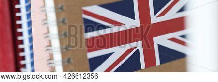 Books With English Flag Are On Shelf Closeup