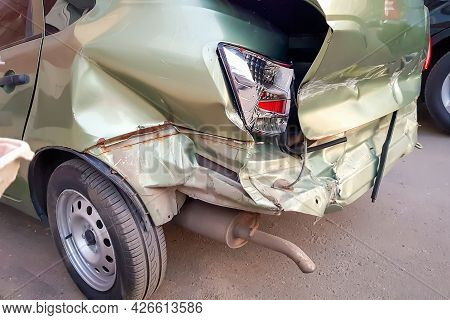 Close-up And Selective Focus Of A Badly Broken Car With Torn, Crumpled And Scratched Parts After A M