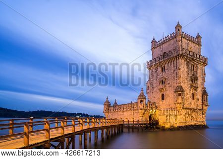 Belem Tower At Night In The Tajo River Bank In Belem Neighborhood. Unesco World Heritage Site.