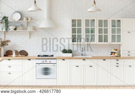 Kitchen Interior With Whitewashed Brick Walls, Modern Furniture, Wooden Countertop