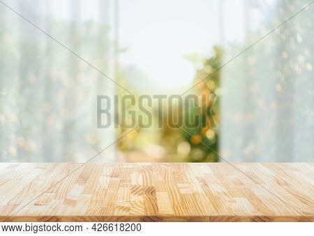 Empty Of Wood Table  On Blur Abstract Garden With Sunlight And Curtain Window , Product Display, Rea