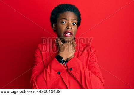 Young african american girl wearing business clothes shouting and suffocate because painful strangle. health problem. asphyxiate and suicide concept.