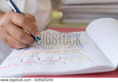 Hands Student Writing Homework Or Note And Testing English Language In Exercise, Taking Fill In Note