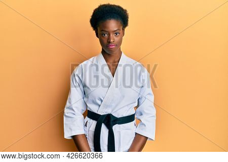 Young african american girl wearing karate kimono and black belt depressed and worry for distress, crying angry and afraid. sad expression.