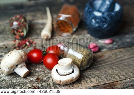 Cooking Background With Different Seasoning. Spices And Vegetable, Closeup. Rustic Style. Food And S